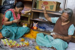 Indian women crafting the angels