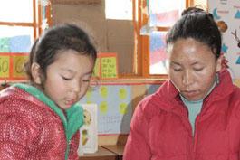 Giving at Norbulingka