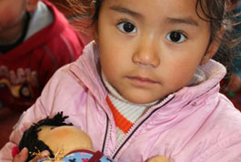 Girl with a small Tibetan doll